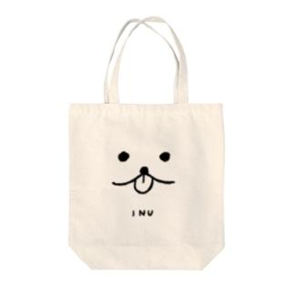 犬の顔 Tote bags