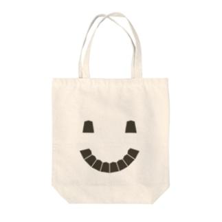 Koma smile Tote bags