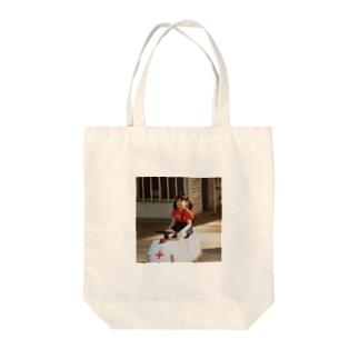 つきおか Tote bags