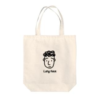 面長 Tote bags