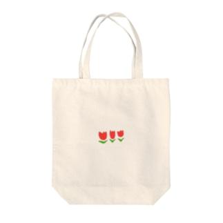 あかチューリップ Tote bags