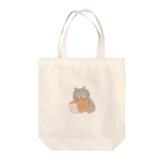 食パンをむさぼるブリショ Tote bags