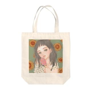pocopiの雑貨屋のキャンディーと女の子 Tote bags
