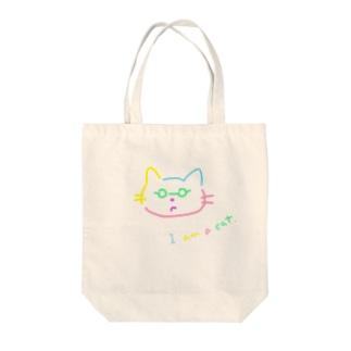 不満げなネコ Tote bags
