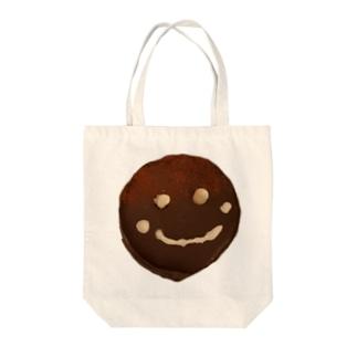 ザッハトルテの微笑み Tote bags