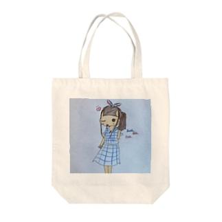 赤と青のリボンの女の子 Tote bags