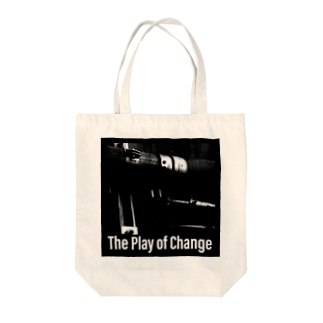 The Play of Change Tote bags