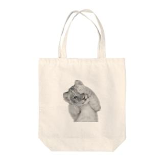 ねむいタイガー Tote bags