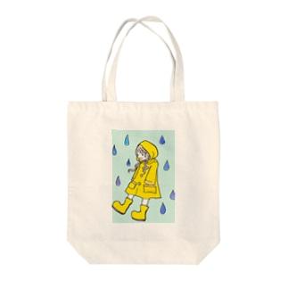 raincoat girl Tote bags