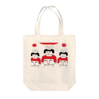 不安 Tote bags