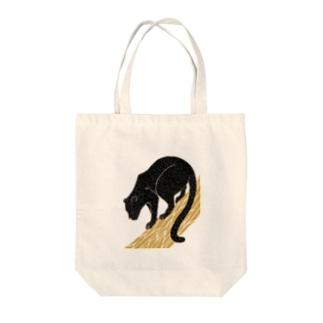 クロヒョウ Tote bags
