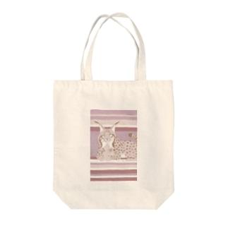 スペインオオヤマネコ Tote bags