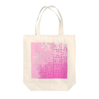 ピンクジグソー Tote bags