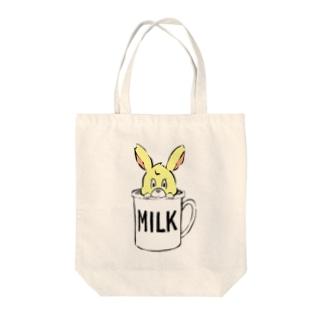 カップに入ったウサギちゃん Tote bags