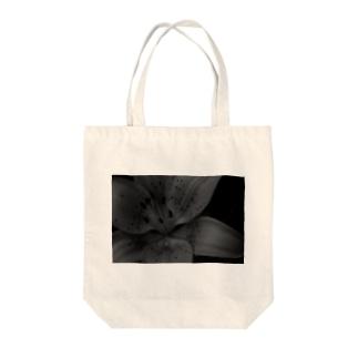艶美 Tote bags