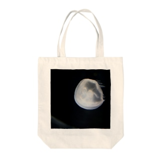 swimming moon Tote bags