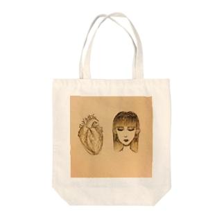 心臓と人間女 Tote bags