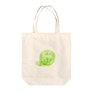 ノートに描いたリンゴ Tote bags
