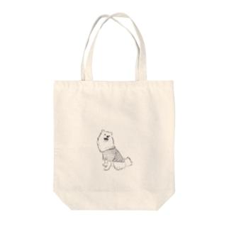 おすわりをした日本スピッツ Tote bags