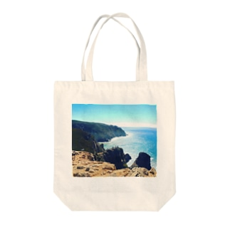 Point of east Tote bags