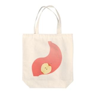 胃の中のリンゴ Tote bags