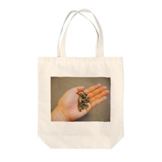 ひまわりの種どうぞ Tote bags