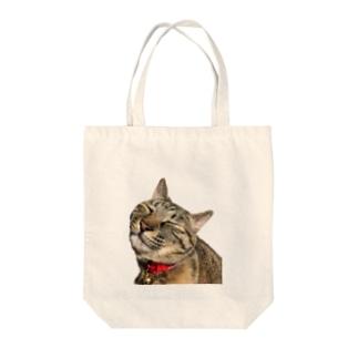 ねこまちランドのモカのお眠りタイム Tote bags