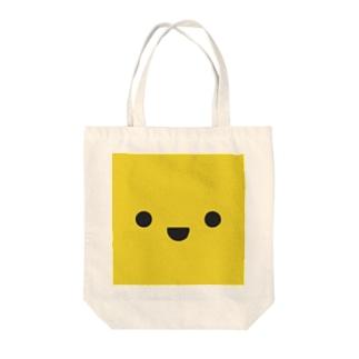 きいろいやつ Tote bags