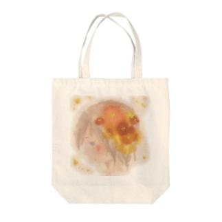 横顔と花 Tote bags