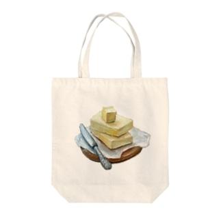 バター Tote bags