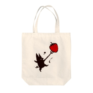 A black pig and a strawberry Tote bags