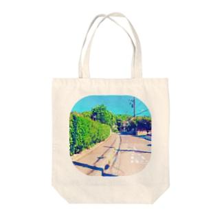 トビダシチュウイ Tote bags