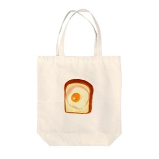 食パンにハム、目玉焼き Tote bags