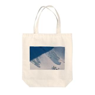 なだれ Tote bags