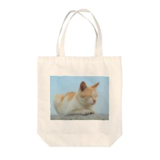 ねむいにゃんこ Tote bags