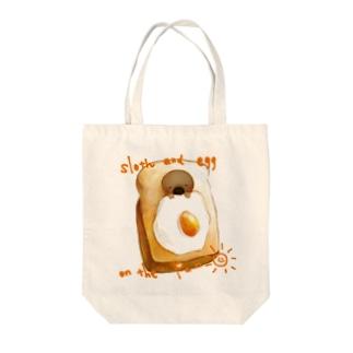 sloth breakfast Tote bags