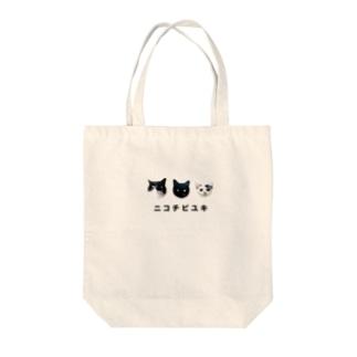 ニコチビユキ Tote bags