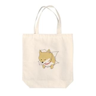 突きぬ犬(茶) Tote bags