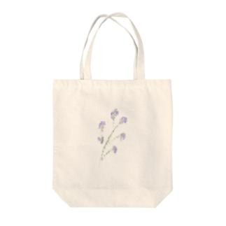 小さな青い花 Tote bags