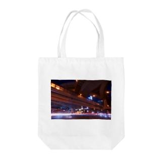 光跡 Tote bags