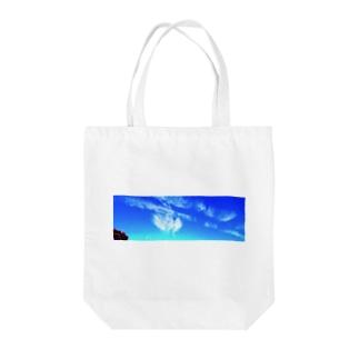 麒麟 Tote bags