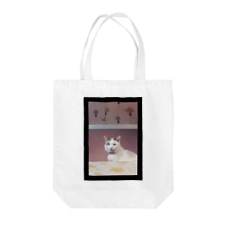 素敵な左目の猫。 Tote bags