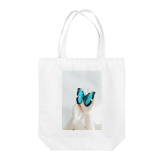 Morpho Tote bags