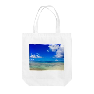 Heaven's blue Tote bags