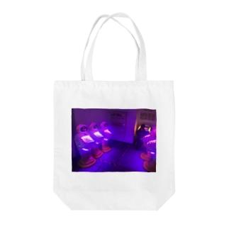 room1 Tote bags