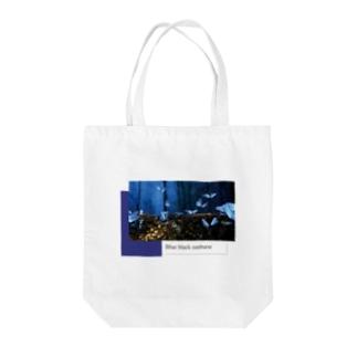 Blue Black Sunburst Tote bags
