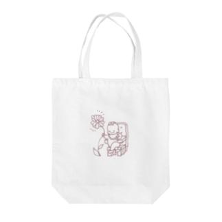 花を掴む偉い赤ちゃん Tote bags