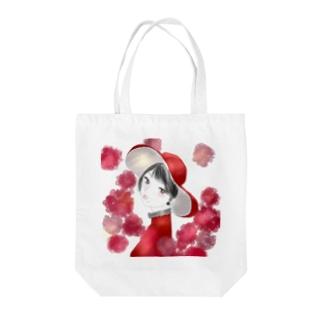 カーネーションと紅色に染まる Tote Bag